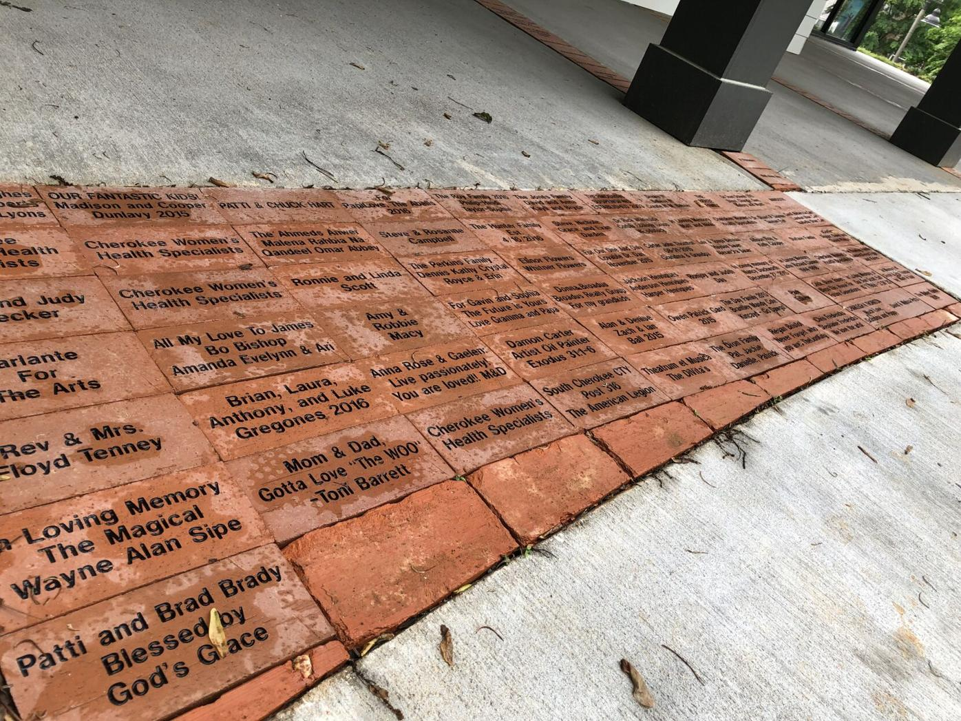 An area of bricks at the front showcases names of people who helped [sic] raised funds for the creation of the arts center. Ethan Johnson